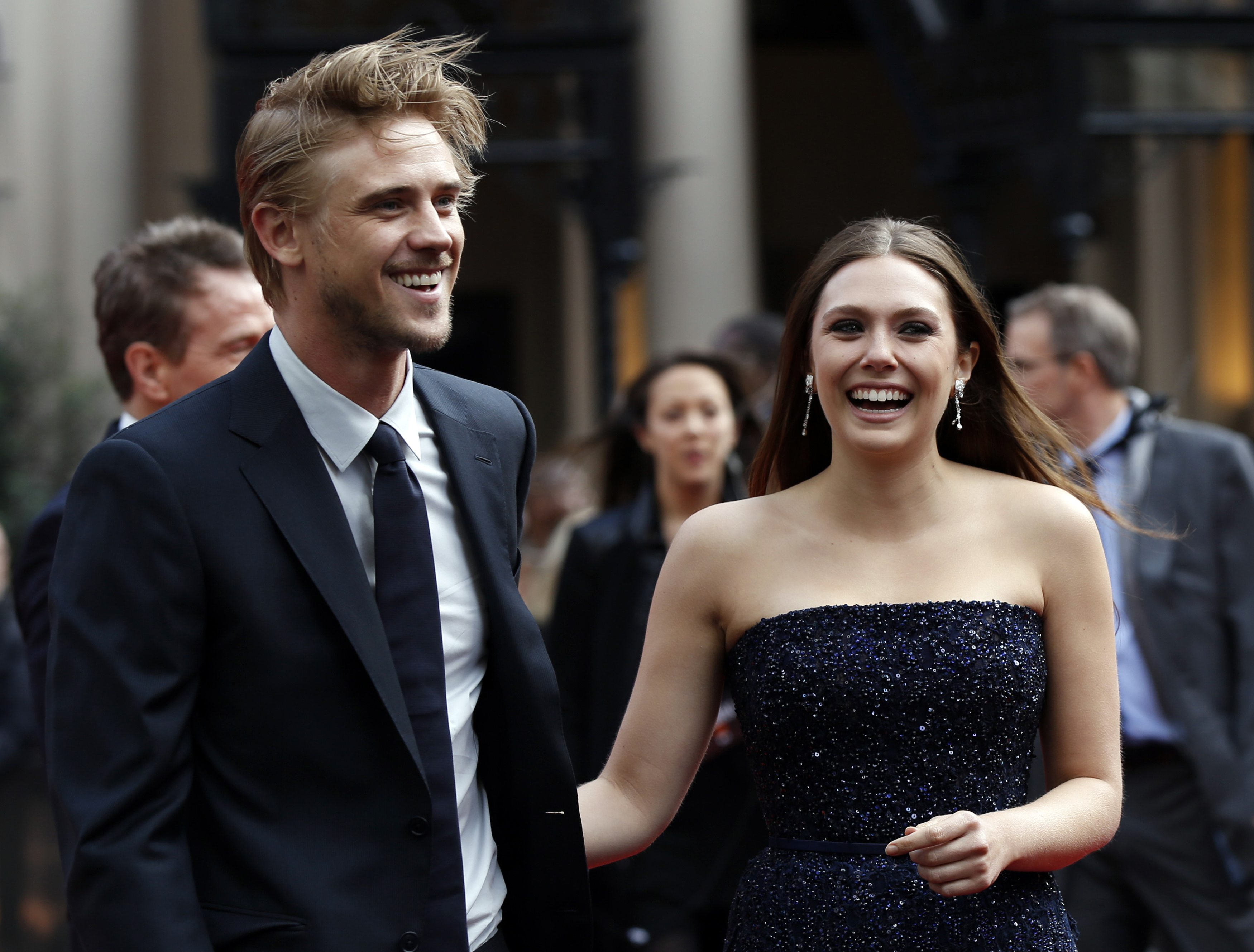 Cast member Elizabeth Olsen and her fiance Boyd Holbrook attend the Godzilla Premiere in central London
