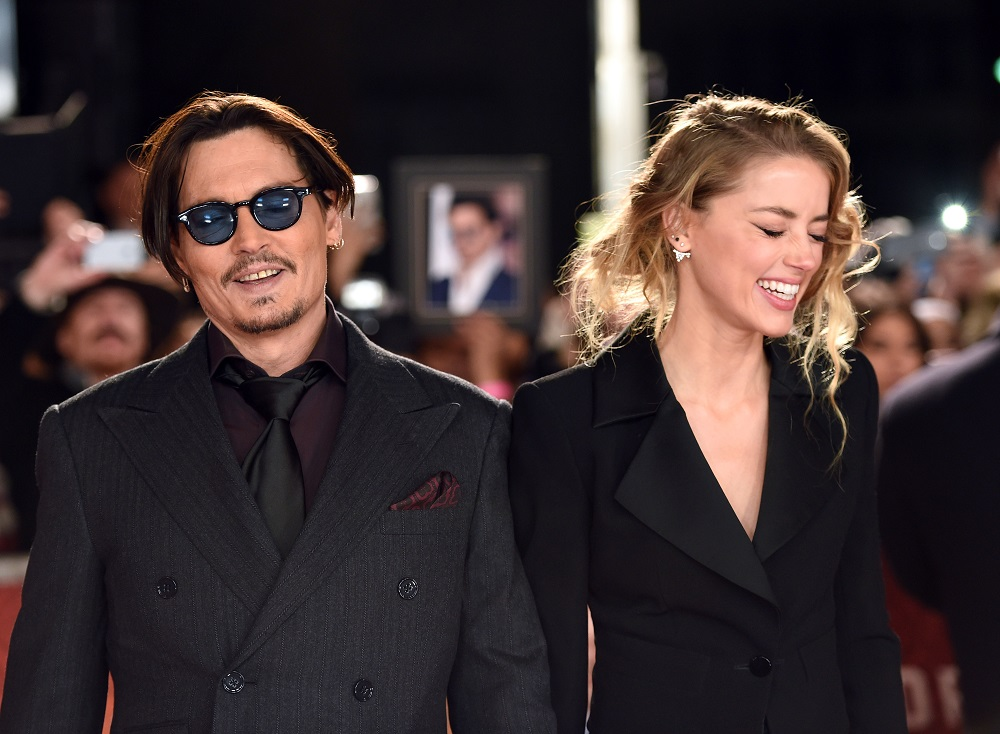 """LONDON, ENGLAND - JANUARY 19: Johnny Depp and Amber Heard attend the UK Premiere of """"Mortdecai"""" at Empire Leicester Square on January 19, 2015 in London, England. (Photo by Karwai Tang/WireImage)"""