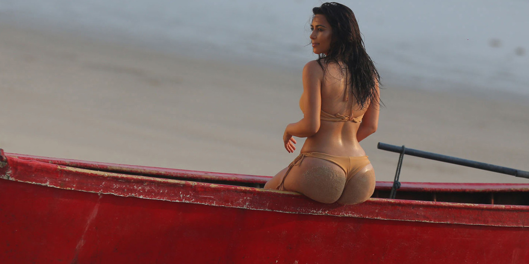 EXCLUSIVE: **PREMIUM EXCLUSIVE**Kim Kardashian shows off her famous booty in a nude-coloured bikini on a photo shoot in Thailand. Picture taken March 31. Pictured: Kim Kardashian Ref: SPL734500 080414 EXCLUSIVE Picture by: Brian Prahl / Splash News Splash News and Pictures Los Angeles:310-821-2666 New York: 212-619-2666 London: 870-934-2666 photodesk@splashnews.com