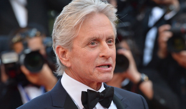 "US actor Michael Douglas arrives on May 21, 2013 for the screening of the film ""Behind the Candelabra"" presented in Competition at the 66th edition of the Cannes Film Festival in Cannes. Cannes, one of the world's top film festivals, opened on May 15 and will climax on May 26 with awards selected by a jury headed this year by Hollywood legend Steven Spielberg. AFP PHOTO / ALBERTO PIZZOLI (Photo credit should read ALBERTO PIZZOLI/AFP/Getty Images)"