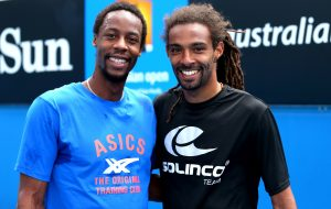 Dustin Brown of Germany in action during a practice session with Gael Monfils of France at the Australian Open, 2014