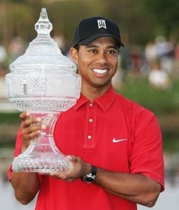 MIAMI, FL - MARCH 6: Tiger Woods holds the winner's trophy after winning the Ford Championship at Doral on March 6, 2005 at the Doral Golf Resort and Spa in Miami, Florida. (Photo by Andy Lyons/Getty Images)