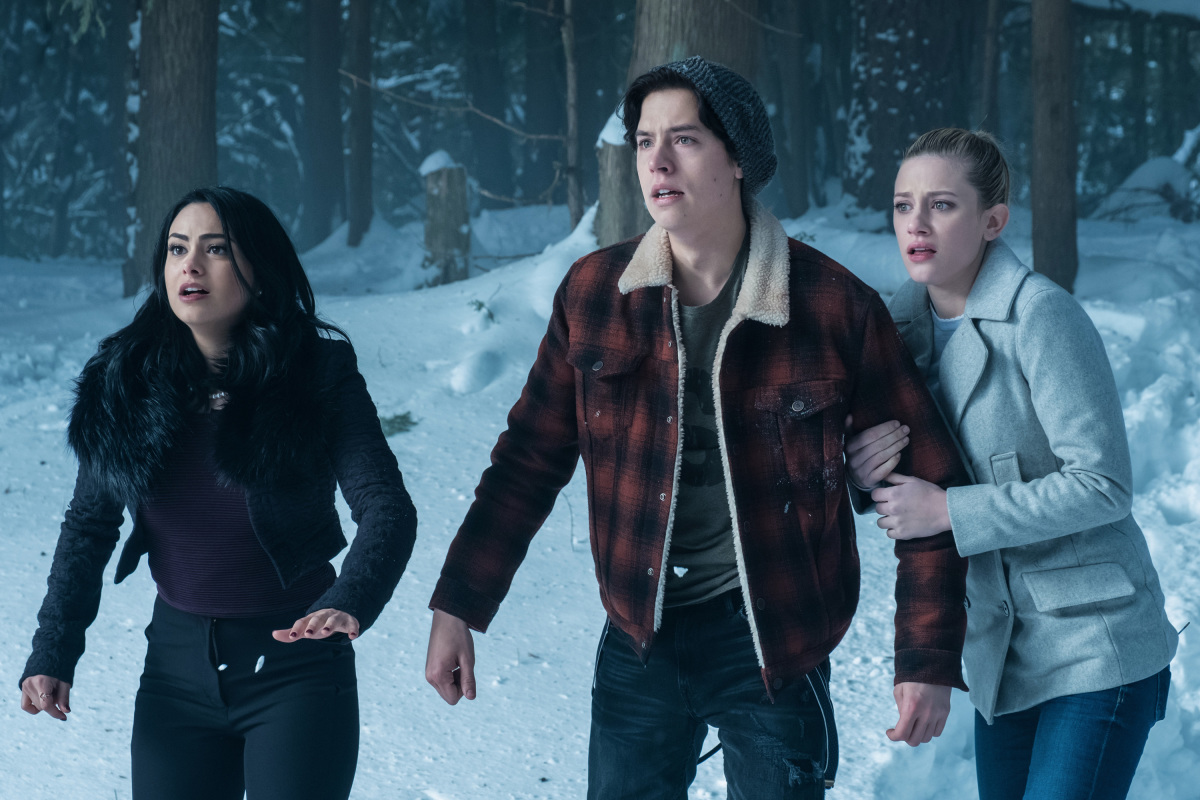 "Riverdale -- ""Chapter Thirteen: The Sweet Hereafter"" -- Image Number: RVD113a_0053.jpg -- Pictured (L-R): Camila Mendes as Veronica Lodge, Cole Sprouse as Jughead Jones, and Lili Reinhart as Betty Cooper -- Photo: Katie Yu/The CW -- © 2017 The CW Network. All Rights Reserved"