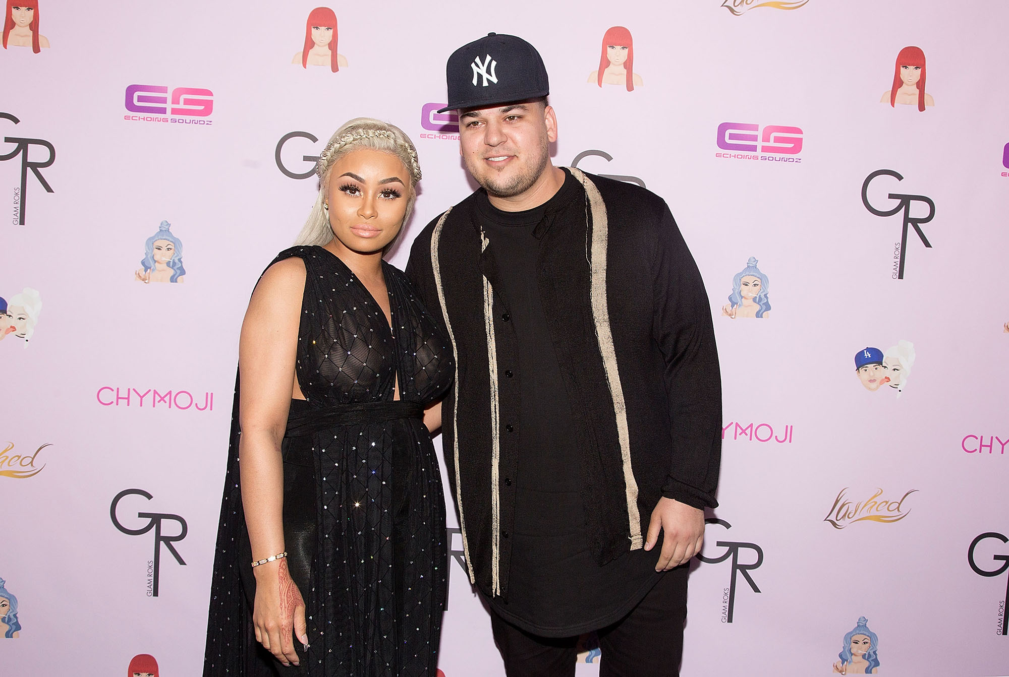 "HOLLYWOOD, CA - MAY 10: Blac Chyna (L) and Rob Kardashian arrive for her Blac Chyna's birthday celebration and unveiling of her ""Chymoji"" Emoji Collection at Hard Rock Cafe, Hollywood, CA on May 10, 2016 in Hollywood, California. (Photo by Gabriel Olsen/WireImage)"
